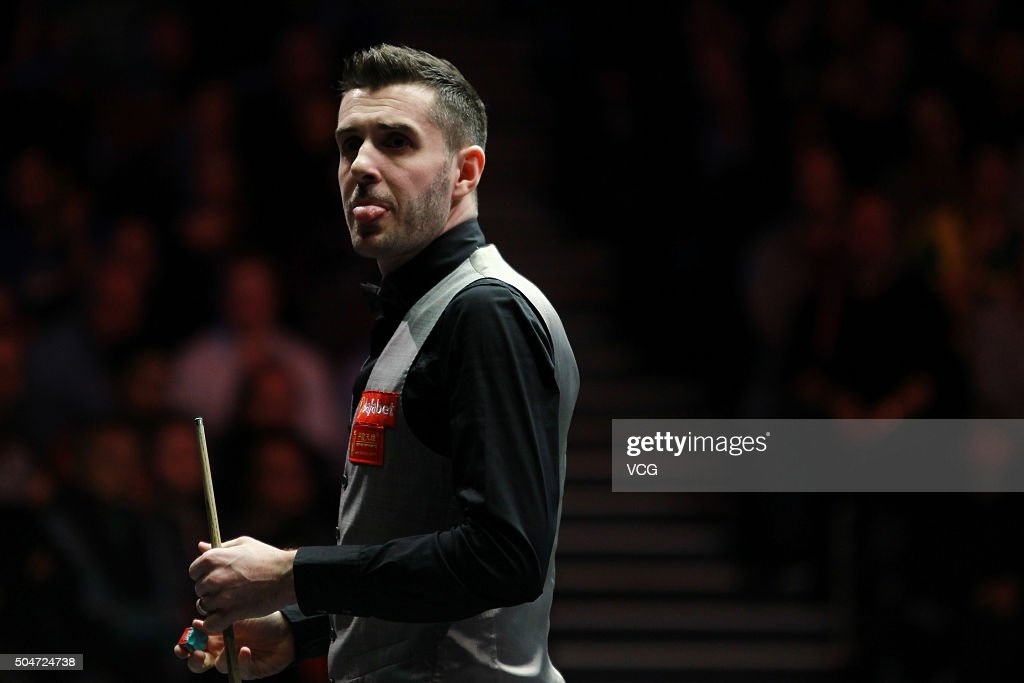 Mark Selby of England reacts in the first round match against Ricky Walden of England during day three of the Dafabet Masters 2016 at Alexandra...