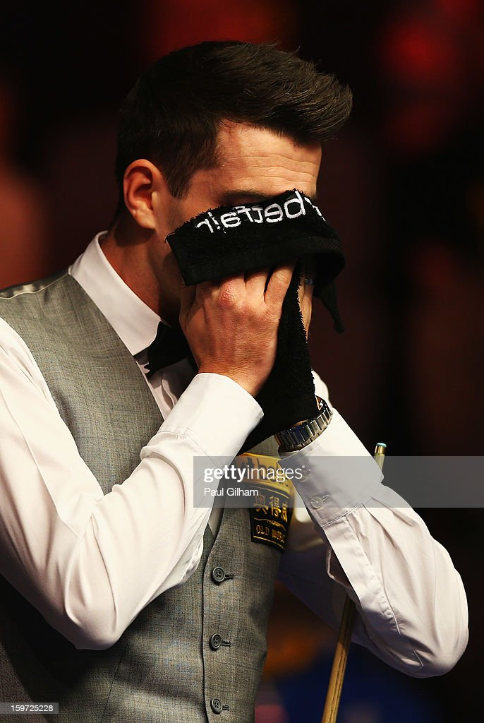 <a gi-track='captionPersonalityLinkClicked' href=/galleries/search?phrase=Mark+Selby&family=editorial&specificpeople=676444 ng-click='$event.stopPropagation()'>Mark Selby</a> of England reacts to a shot during the semi-final match between Graeme Dott of Scotland and <a gi-track='captionPersonalityLinkClicked' href=/galleries/search?phrase=Mark+Selby&family=editorial&specificpeople=676444 ng-click='$event.stopPropagation()'>Mark Selby</a> of England at Alexandra Palace on January 19, 2013 in London, England.