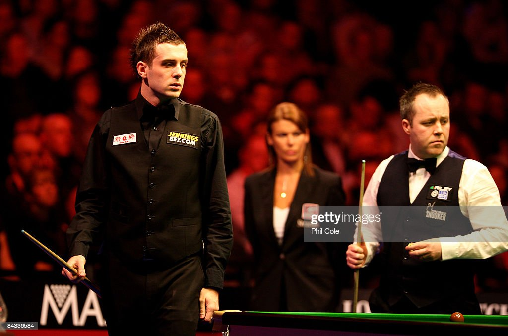 Mark Selby of England with John Higgins of Scotland during the Masters Snooker at Wembley Conference Centre on January 17 2009 in London England