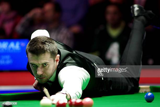 Mark Selby of UK plays a shot against David Morris of UK on day five of the 2014 Coral UK Championship at York Barbican on November 29 2014 in York...