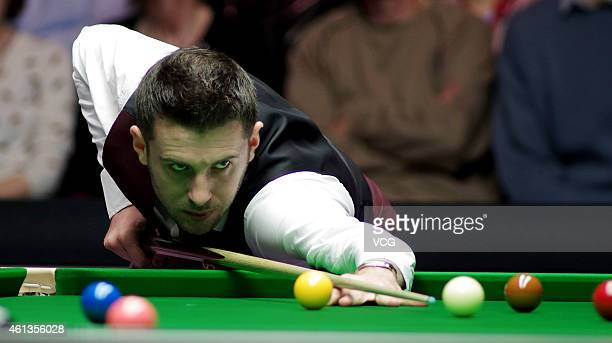 Mark Selby of UK plays a shot against Shaun Murphy of UK during day one of the 2015 Dafabet Masters at Alexandra Palace on January 11 2015 in London...