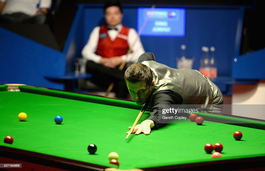 Mark Selby plays a shot against Ding Junhui during the World Snooker Championship final at the Crucible Theatre on May 02 2016 in Sheffield England