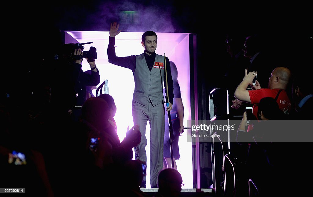 Mark Selby walks into the arena ahead of the final session of the World Snooker Championship final at the Crucible Theatre on May 02 2016 in...