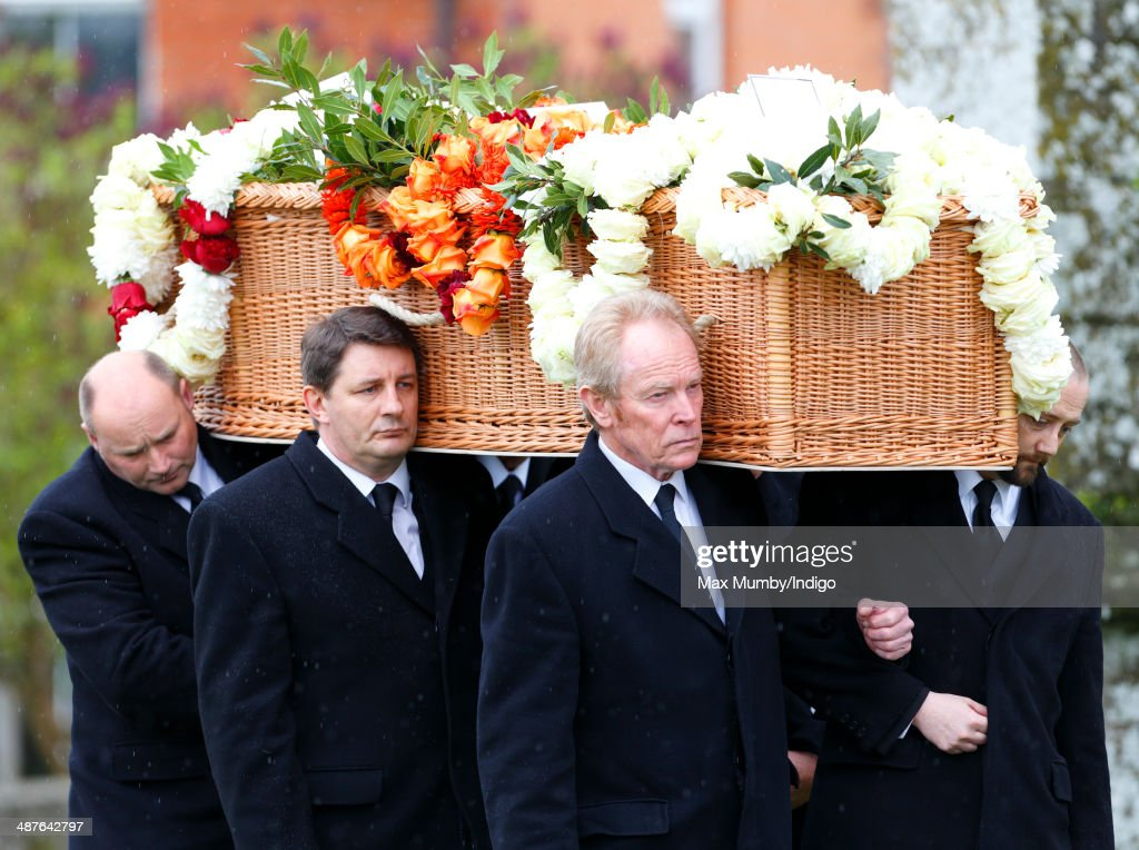 Mark Shand's coffin is carried into Holy Trinity Church, Stourpaine for his funeral on May 1, 2014 near Blandford Forum in Dorset, England. Conservationist and travel writer Mark Shand, brother of Camilla, Duchess of Cornwall, died unexpectedly last week after falling and hitting his head in New York.