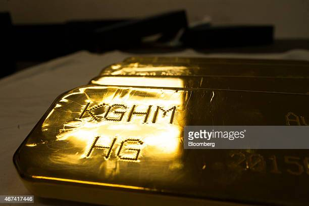 A KGHM mark sits on a newly cast gold bullion bar ahead of export at the KHGM Polska Miedz SA smelting plant in Glogow Poland on Monday March 23 2015...