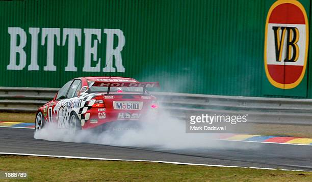 Mark Skaife of the Holden Racing team locks up his brakes before hitting the wall during the Top 15 Shootout in the Betta Electrical V8 Ultimate the...