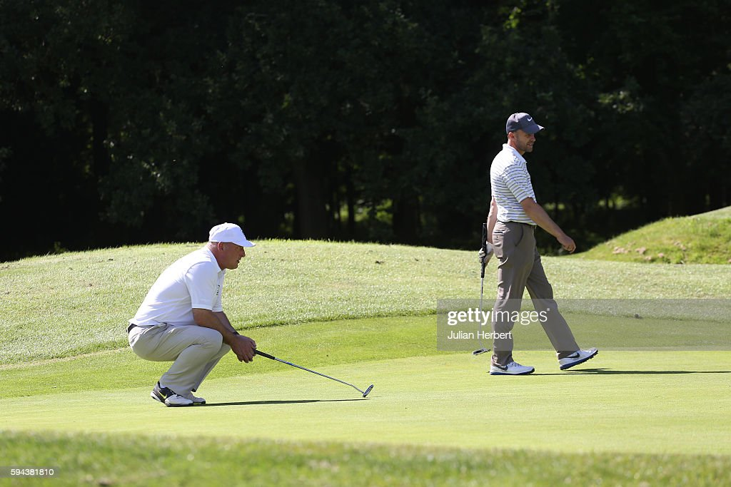 Mark Slater and Andrew Davies of Bewdley Pines Golf Club line up a putt during The PGA ProCaptain South West Qualifier at Bowood Golf Course on...