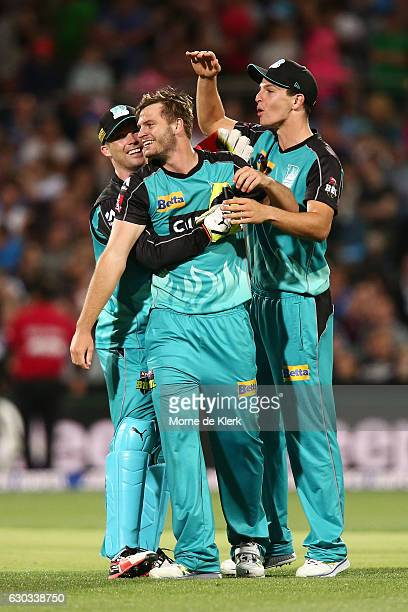 Mark Steketee of the Brisbane Heat celebrates with teammates after getting the wicket of Jake Lehmann of the Adelaide Strikers during the Big Bash...