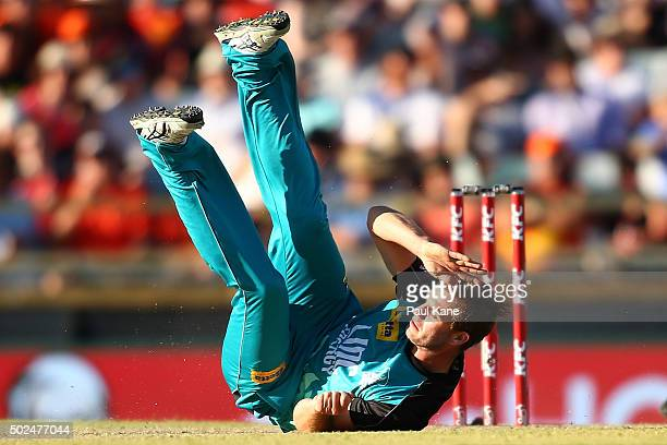 Mark Steketee of the Heat slips after a delivery during the Big Bash League match between the Perth Scorchers and the Brisbane Heat at WACA on...