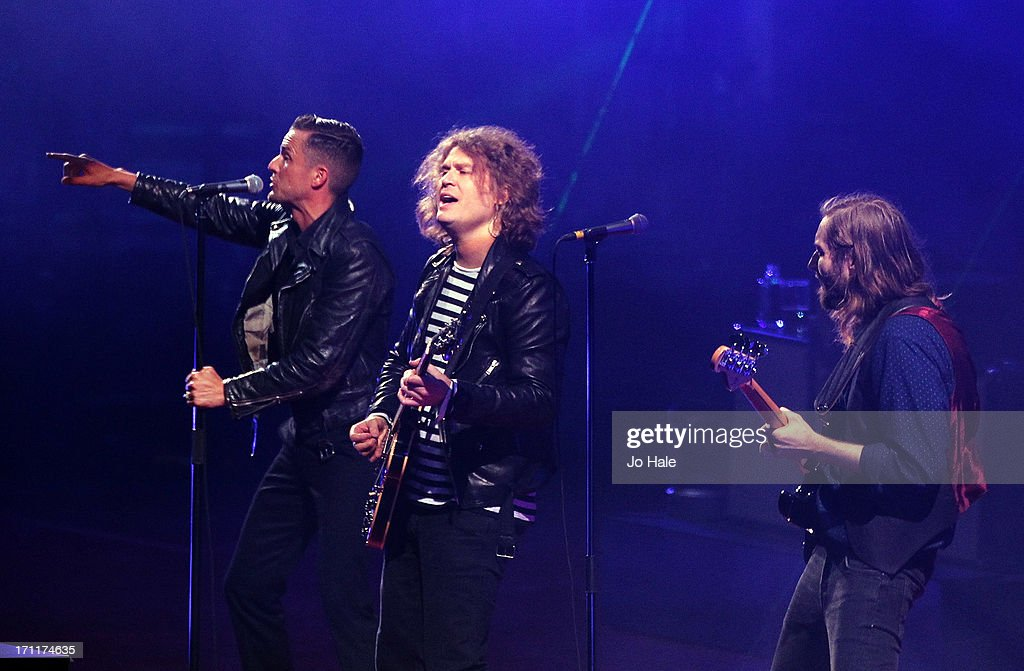 <a gi-track='captionPersonalityLinkClicked' href=/galleries/search?phrase=Mark+Stoermer&family=editorial&specificpeople=234409 ng-click='$event.stopPropagation()'>Mark Stoermer</a>, Brandon Flowers and Dave Keuning of The Killers perform on stage at Wembley Stadium on June 22, 2013 in London, England.