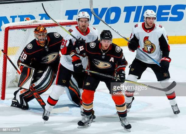 Mark Stone and Bobby Ryan of the Ottawa Senators battle for position in front of the net against Cam Fowler and Ryan Miller of the Anaheim Ducks...