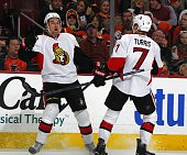 Mark Stone left of the Ottawa Senators reacts with teammate Kyle Turris after scoring against the Philadelphia Flyers during third period at Wells...