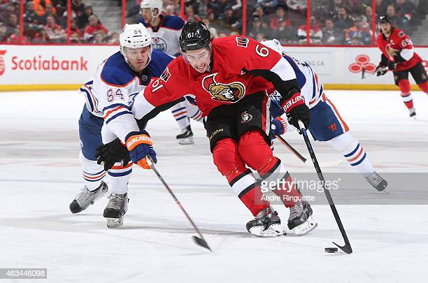 Mark Stone of of the Ottawa Senators charges past Oscar Klefbom of the Edmonton Oilers with the puck at Canadian Tire Centre on February 14 2015 in...