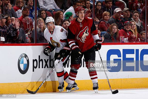 Mark Stone of the Ottawa Senators and Michael Stone of the Arizona Coyotes come together along the boards during the third period of the NHL game at...