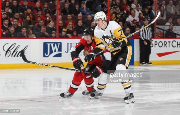 Mark Stone of the Ottawa Senators battles for position against Evgeni Malkin of the Pittsburgh Penguins at Canadian Tire Centre on November 16 2017...