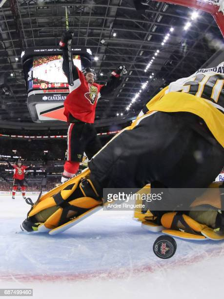 Mark Stone of the Ottawa Senators celebrates a second period goal by Bobby Ryan as the puck goes into the net behind Matt Murray of the Pittsburgh...