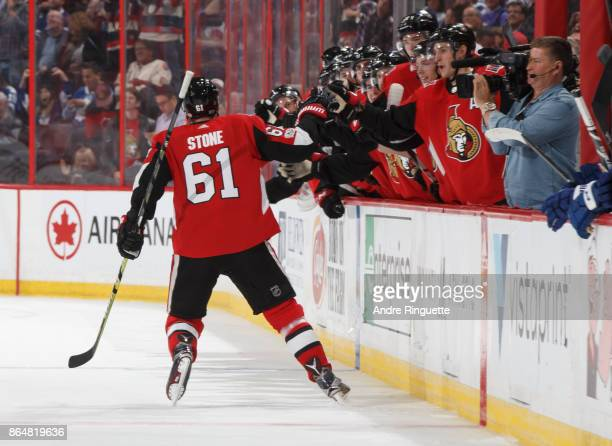 Mark Stone of the Ottawa Senators celebrates his first of two third period goals against the Toronto Maple Leafs with teammates at the players bench...
