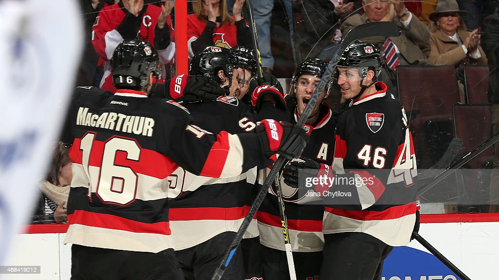 Mark Stone of the Ottawa Senators celebrates his first period goal against the Tampa Bay Lightning with team mates Clarke MacArthur Cody Ceci Patrick...