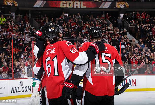Mark Stone of the Ottawa Senators celebrates his first period powerplay goal with team mate Zack Smith against the Boston Bruins at Canadian Tire...