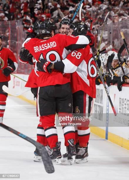 Mark Stone of the Ottawa Senators celebrates his first period goal against the Boston Bruins with teammates Derick Brassard and Mike Hoffman in Game...
