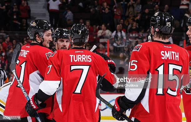 Mark Stone of the Ottawa Senators celebrates his late third period goal and second goal of the game against the Boston Bruins with team mates Kyle...
