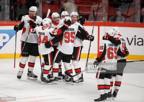 Mark Stone of the Ottawa Senators celebrates his overtime gamewinning goal against the Colorado Avalanche with teammates Ben Harpur JeanGabriel...