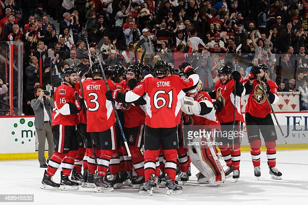 Mark Stone of the Ottawa Senators celebrates his overtime goal against the Pittsburgh Penguins with his ream mates at Canadian Tire Centre on April 7...