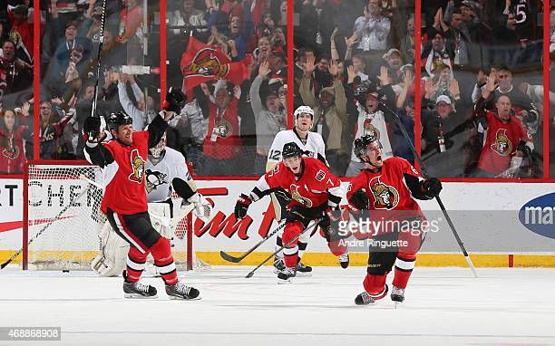 Mark Stone of the Ottawa Senators celebrates his overtime winning goal with teammates Marc Methot and Kyle Turris as MarcAndre Fleury and Ben Lovejoy...