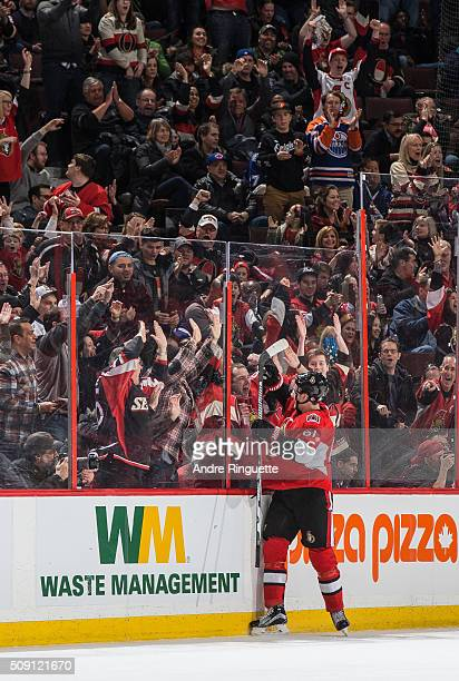 Mark Stone of the Ottawa Senators celebrates his second goal of the game against the Tampa Bay Lightning with fans along the glass at Canadian Tire...
