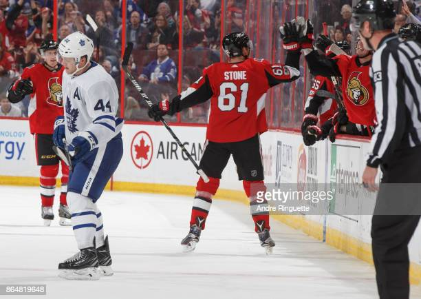 Mark Stone of the Ottawa Senators celebrates his third period empty net goal with teammates at the players bench as Morgan Rielly of the Toronto...