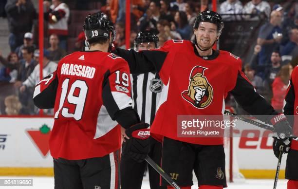 Mark Stone of the Ottawa Senators celebrates his third period empty net goal against the Toronto Maple Leafs with teammate Derick Brassard at...
