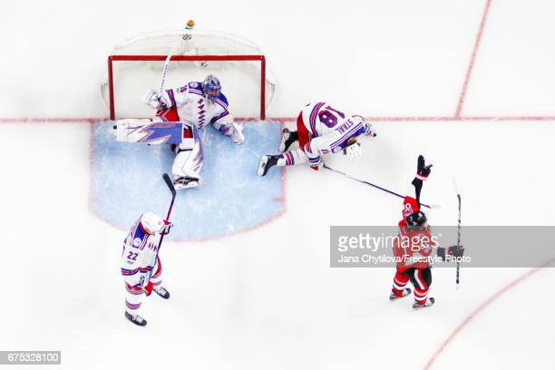 Mark Stone of the Ottawa Senators celebrates his third period goal as Chris Kelly Henrik Lundqvist and Marc Staal of the New York Rangers react in...