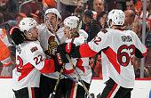 Mark Stone of the Ottawa Senators celebrates his third period goal against the Philadelphia Flyers his second of the game with teammates Erik Condra...