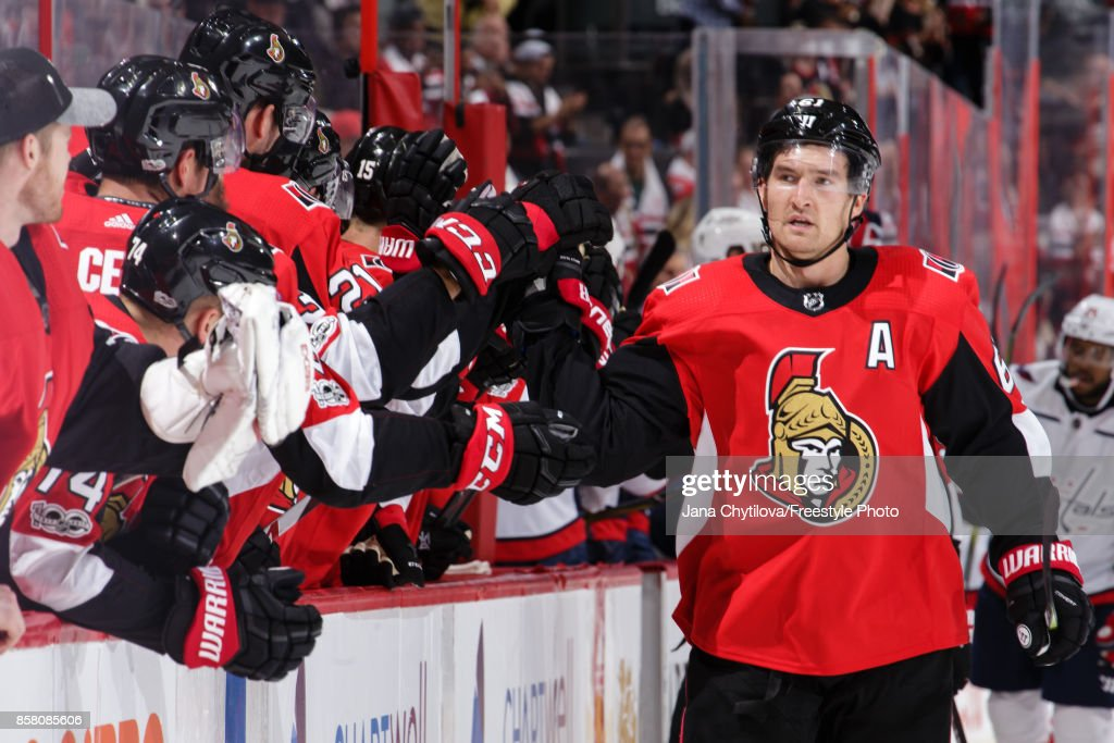 Mark Stone #61 of the Ottawa Senators celebrates his third period goal and second of the game against the Washington Capitals with teammates at the bench at Canadian Tire Centre on October 5, 2017 in Ottawa, Ontario, Canada.