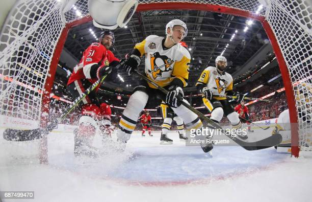Mark Stone of the Ottawa Senators drives to the net against Olli Maatta and Trevor Daley of the Pittsburgh Penguins in Game Six of the Eastern...