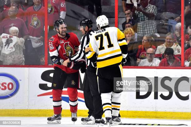 Mark Stone of the Ottawa Senators fights with Evgeni Malkin of the Pittsburgh Penguins during the second period in Game Three of the Eastern...