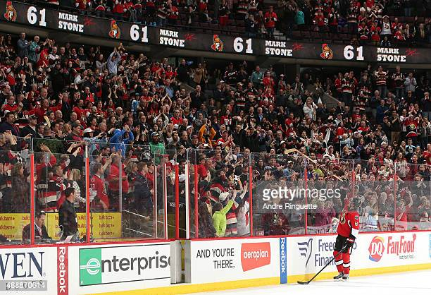 Mark Stone of the Ottawa Senators gives a souvenir stick to a fan as he is named the first star of the game after an overtime win over the Pittsburgh...
