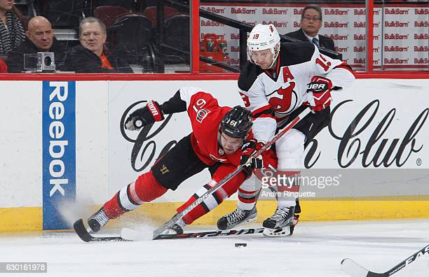 Mark Stone of the Ottawa Senators is knocked off the puck by Travis Zajac of the New Jersey Devils at Canadian Tire Centre on December 17 2016 in...