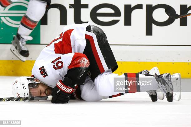 Mark Stone of the Ottawa Senators lays on the ice after a play againt Carter Rowney of the Pittsburgh Penguins during the third period in Game Seven...