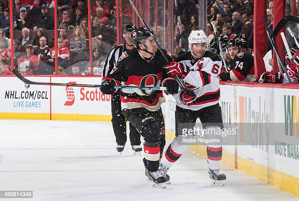 Mark Stone of the Ottawa Senators lines up a body check on Andy Greene of the New Jersey Devils at Canadian Tire Centre on October 22 2015 in Ottawa...
