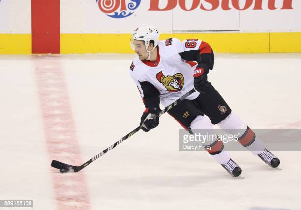 Mark Stone of the Ottawa Senators plays the puck down the ice during second period action against the Winnipeg Jets at the Bell MTS Place on December...