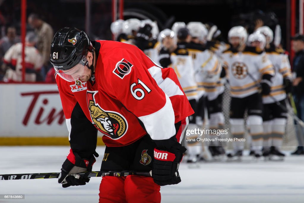 Mark Stone #61 of the Ottawa Senators reacts as the Boston Bruins celebrate a win in Game One of the Eastern Conference First Round during the 2017 NHL Stanley Cup Playoffs at Canadian Tire Centre on April 12, 2017 in Ottawa, Ontario, Canada.