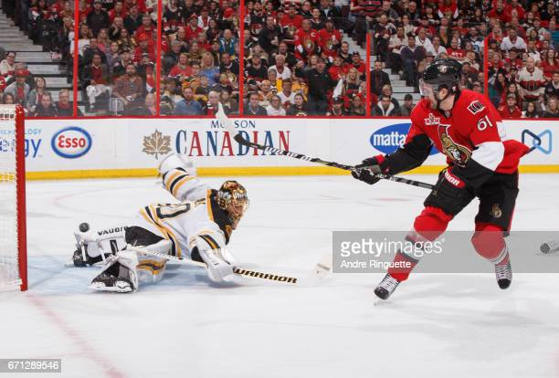 Mark Stone of the Ottawa Senators scores a first period goal on a backhand shot against Tuukka Rask of the Boston Bruins in Game Five of the Eastern...
