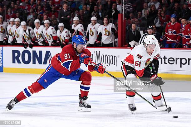 Mark Stone of the Ottawa Senators skates with the puck in front of Lars Eller of the Montreal Canadiens during Game Five of the Eastern Conference...