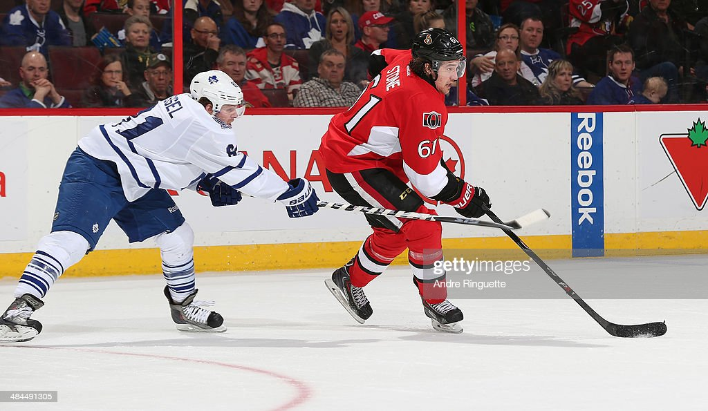 Mark Stone #61 of the Ottawa Senators stickhandles the puck against Phil Kessel #81 of the Toronto Maple Leafs at Canadian Tire Centre on April 12, 2014 in Ottawa, Ontario, Canada.