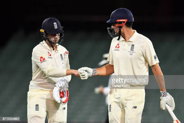 Mark Stoneman of England and Alastair Cook of England react as they walk from the field at the end of day two of the Four Day Tour match between the...