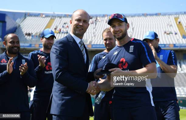 Mark Stoneman of England is presented with his test cap by Jonathan Trott ahead of the 1st Investec Test match between England and West Indies at...