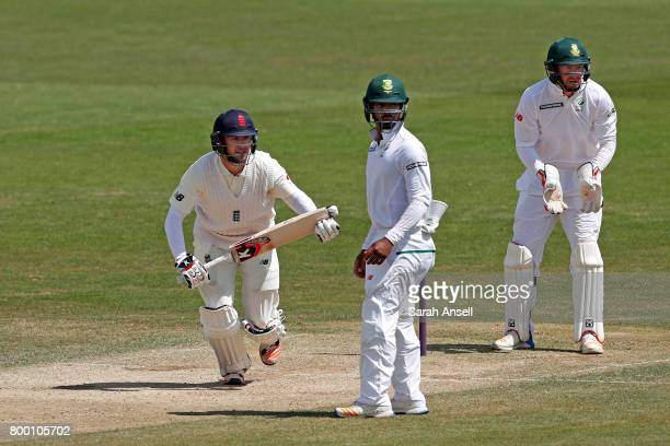 Mark Stoneman of England Lions hits a boundary as South Africa A wicket keeper and fielder Khaya Zondo look on during day 3 of the match between...
