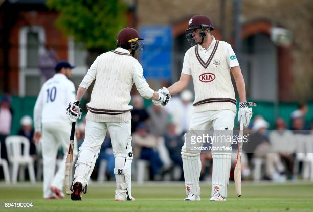 Mark Stoneman of Surrey celebrates his 150 with Dom Sibley of Surrey during the Specsavers County Championship Division One match between Surrey and...