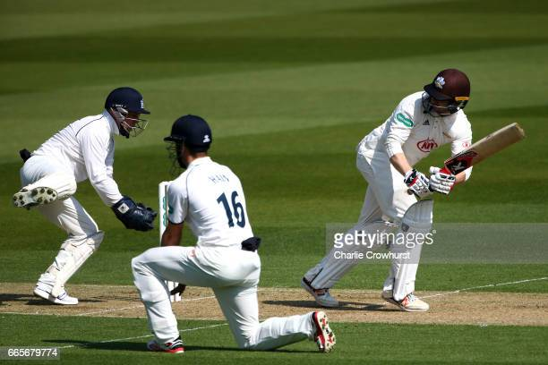 Mark Stoneman of Surrey hits out while Warwickshire's wicket keeper Tim Ambrose and Sam Hain look on during the Specsavers County Championship...
